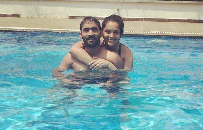 Dinesh Karthik Swims With His Wife In The Pool Images