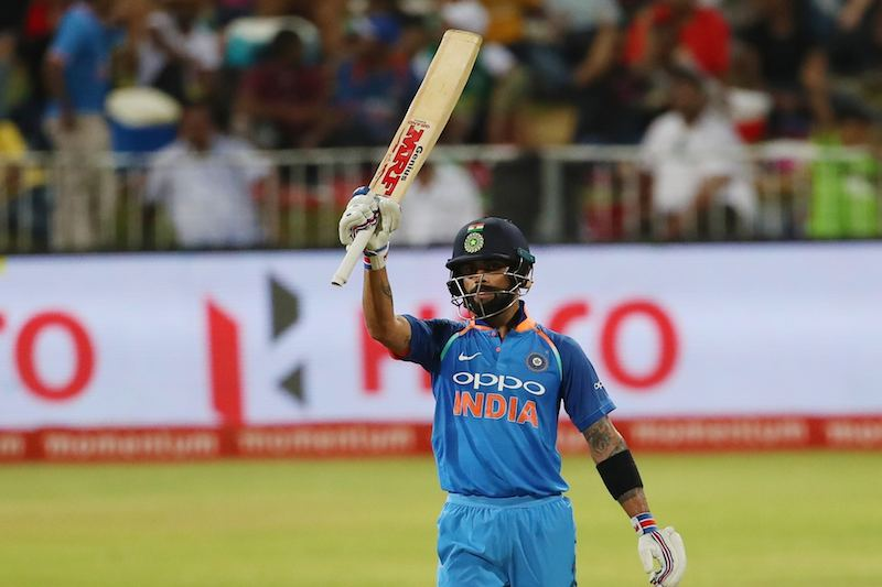Virat Kohli Celebrating His Half Century Images in Hindi
