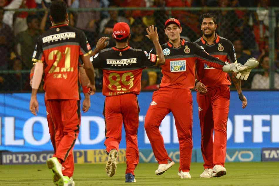 Royal Challengers Bangalore Players Celebrate Fall Of Andre Russells Wicket During An IPL 2018 Image