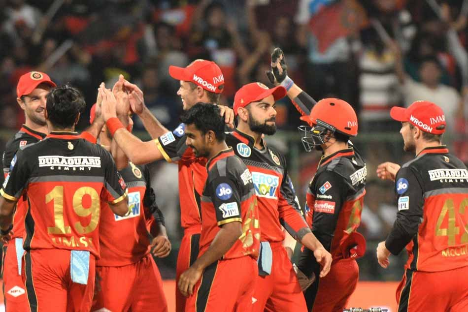 Royal Challengers Bangalore Players Celebrate Fall Of Sunil Narines Wicket During An IPL 2018 Images