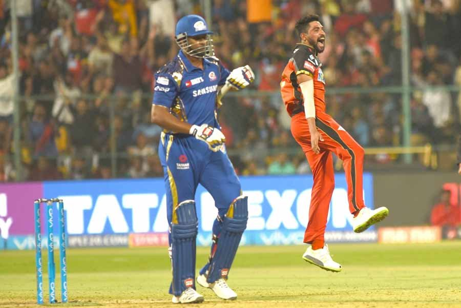 Royal Challengers Bangalores Mohammed Siraj Celebrates Fall Of Kieron Pollards Wicket During An IPL  in Hindi