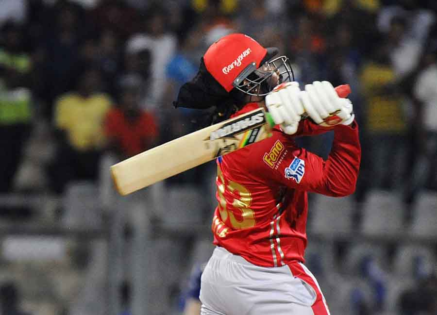 Kings XI Punjabs Chris Gayle In Action During An IPL 2018 Match Images in Hindi