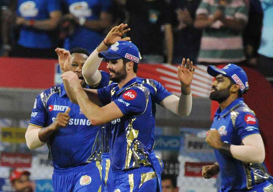Mumbai Indians Celebrate Fall Of Chris Gayles Wicket During An IPL 2018 Match Images in Hindi