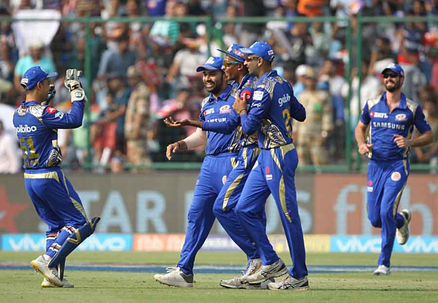 Players Of Mumbai Indians Celebrate The Fall Of Prithvi Shaws Wicket During An IPL 2018 Match Images