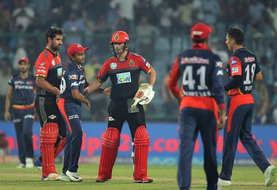 Royal Challengers Bangalores Colin De Grandhomme And AB De Villiers After Winning An IPL 2018 Images