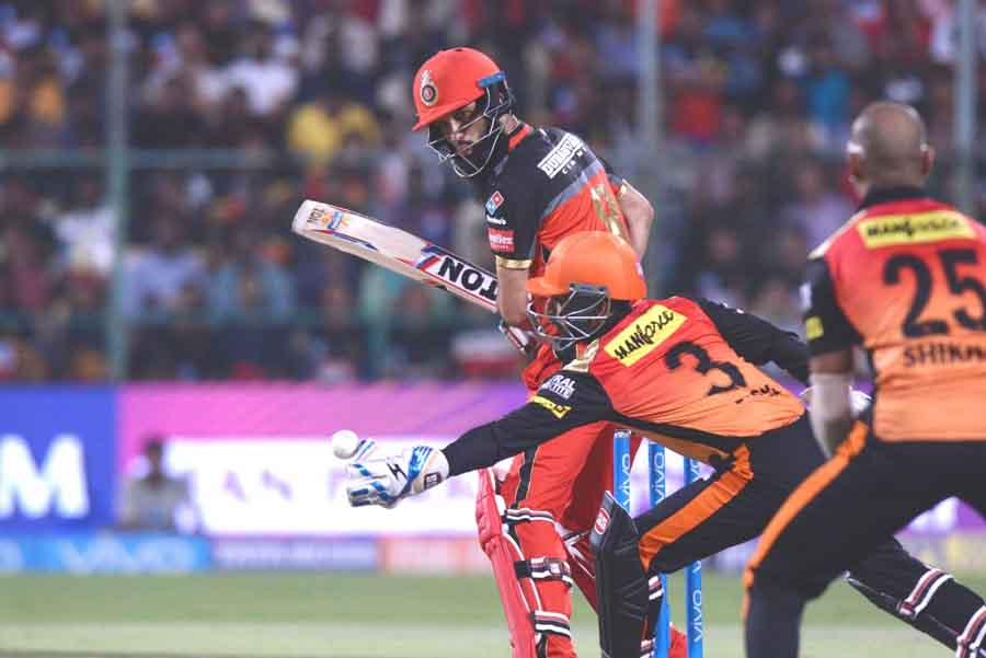 Royal Challengers Bangalores Moeen Ali In Action During An IPL 2018 Match Images