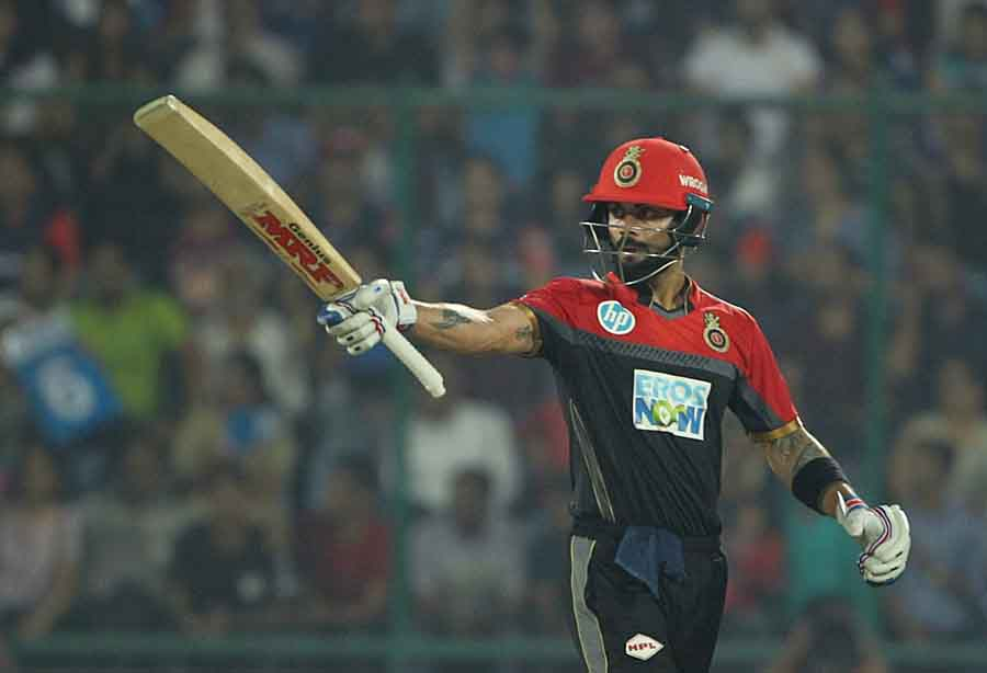 Royal Challengers Bangalores Virat Kohli Celebrates His Half Century During An IPL Match 2018 Images