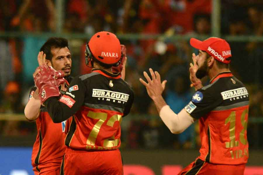 Royal Challengers Bangalores Yuzuvendra Chahal Celebrates Fall Of Shikhar Dhawans Wicket During An I