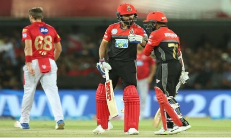 रॉयल चैलेंजर्स बैंगलोर की टीम ने किया धमाका, किंग्स इलेवन पंजाब को 10 विकेट से दी पटखनी Images