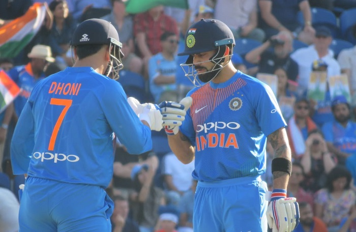 MS Dhoni's late blitz helps India to 148