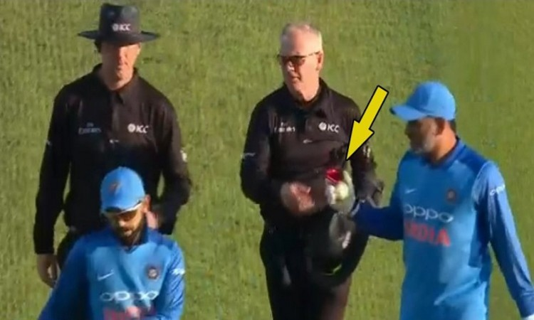 MS Dhoni collects the ball from umpires and raises retirement questions
