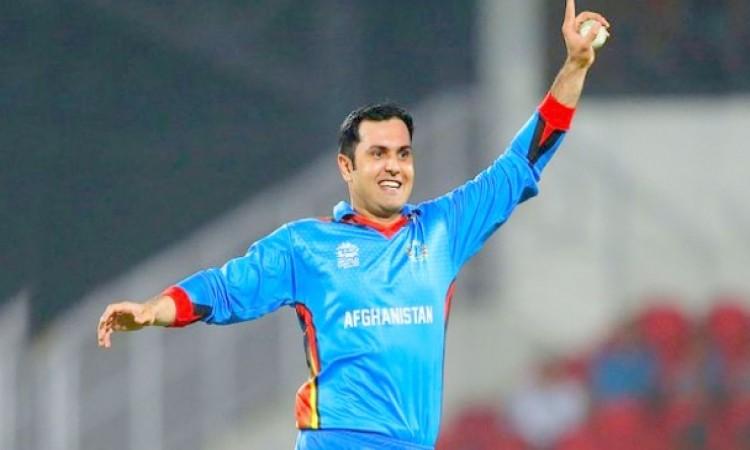अफगानिस्तान के मोहम्मद नबी ने बनाया विश्व रिकॉर्ड, ऐसा करने वाले पहले अफगानिस्तानी खिलाड़ी बने Image