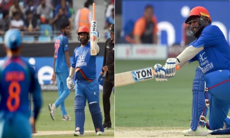 मोहम्मद शहजाद और मोहम्मद नबी की यादगार पारी, भारत को मिला 253 रनों का टारगेट Images