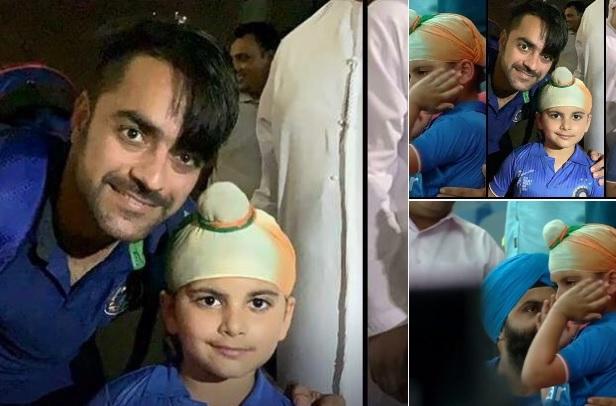 मैच के बाद राशिद खान ने इस रोते हुए बच्चे के साथ फोटो खिंचवाकर जीत लिया हर किसी का दिल Images