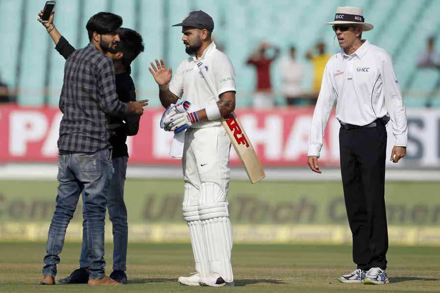 Two Intruders Try To Take Selfies With Indian Captain Virat Kohli After They Entered The Field Durin