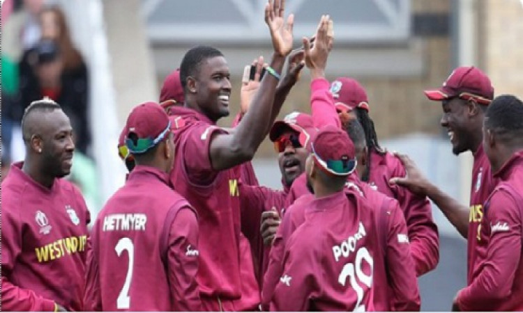Jason Holder WIth Team