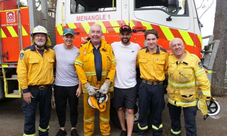 Aussie cricketers pay visit to bushfire heroes Images