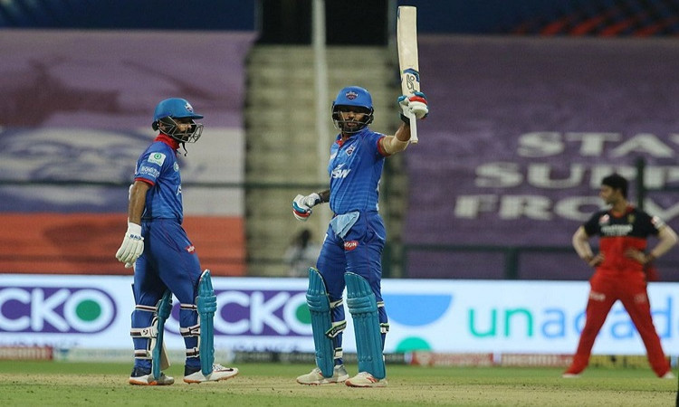 rahane's presence allows me to play freely dhawan