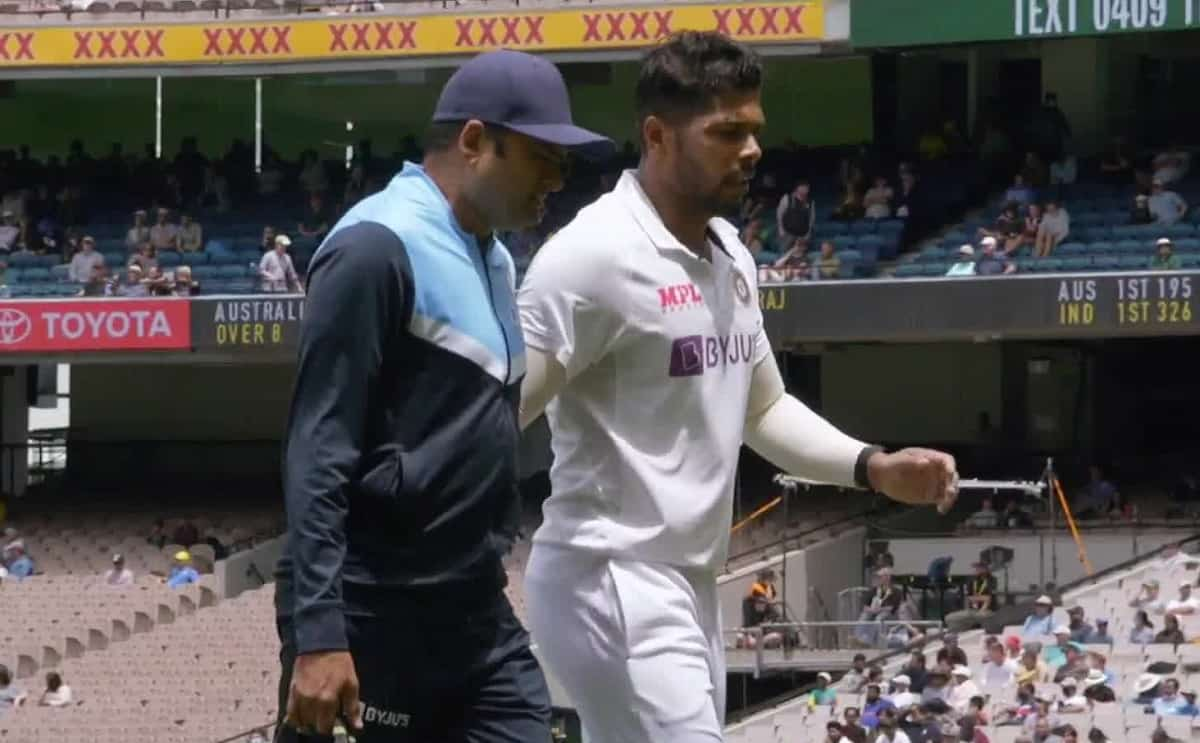 India's Umesh Yadav leaves the field with an injury