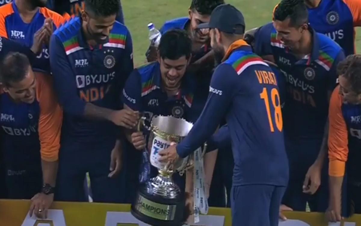 Cricket Image for Virat Kohli Gave The Trophy To Newcomer Ishan Kishan To Lift