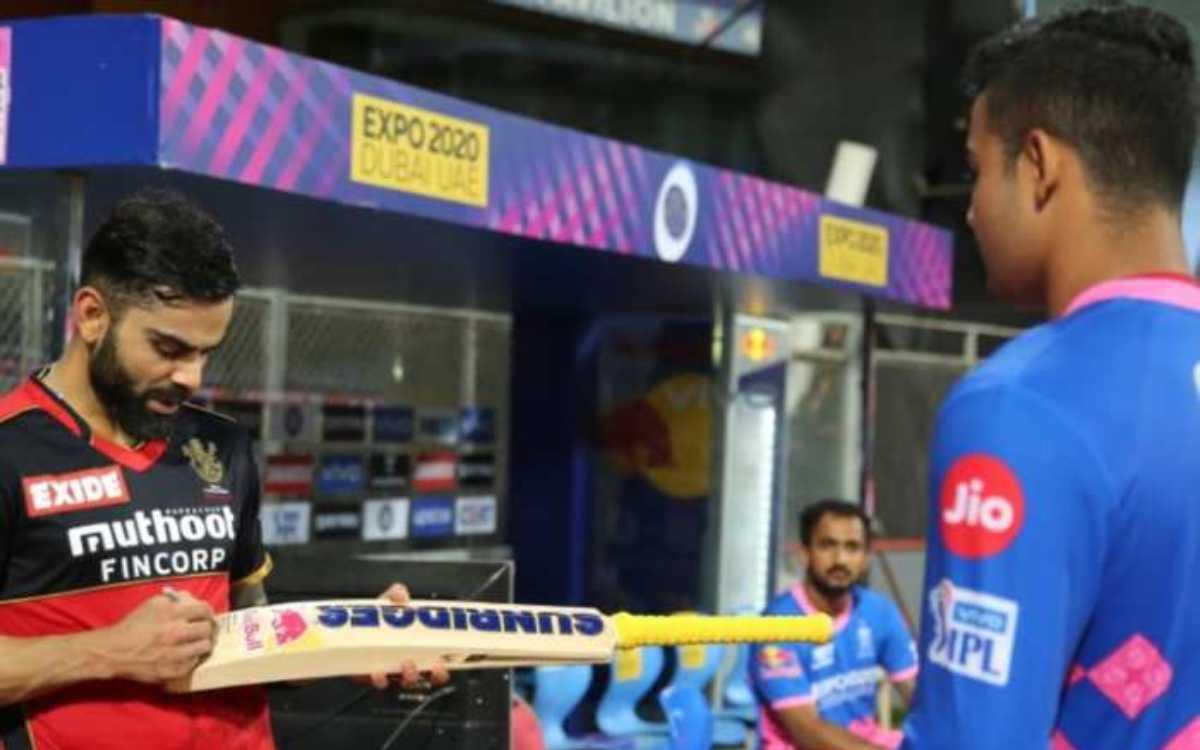 Cricket Image for रियान पराग ने किया खुलासा, बताया- ऑटोग्राफ वाले बैट पर क्या था विराट कोहली का मैसे